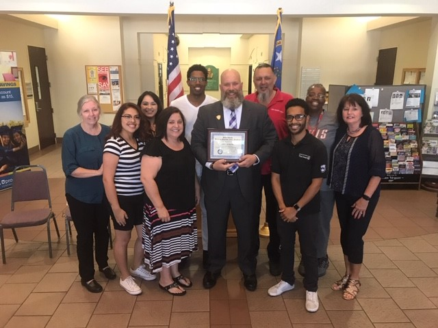 Academic EOC Coordinator Jeff Detrick receives State of Nevada